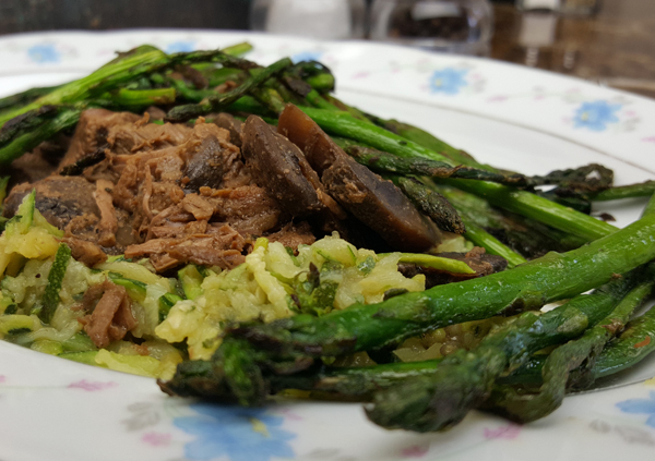 Low Carb Dinner: Beef Tips over zucchini noodles with asparagus